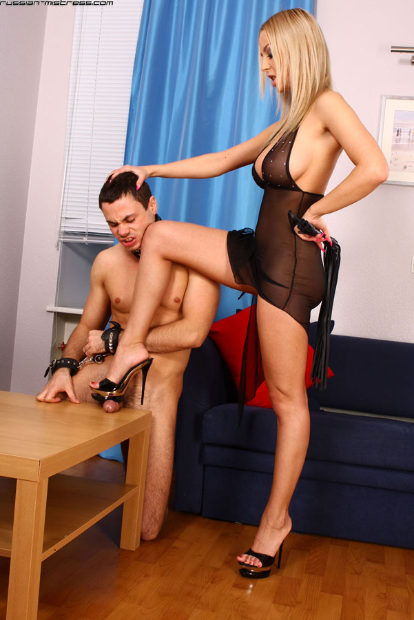 image Blond mistress kicking and punching loser slave